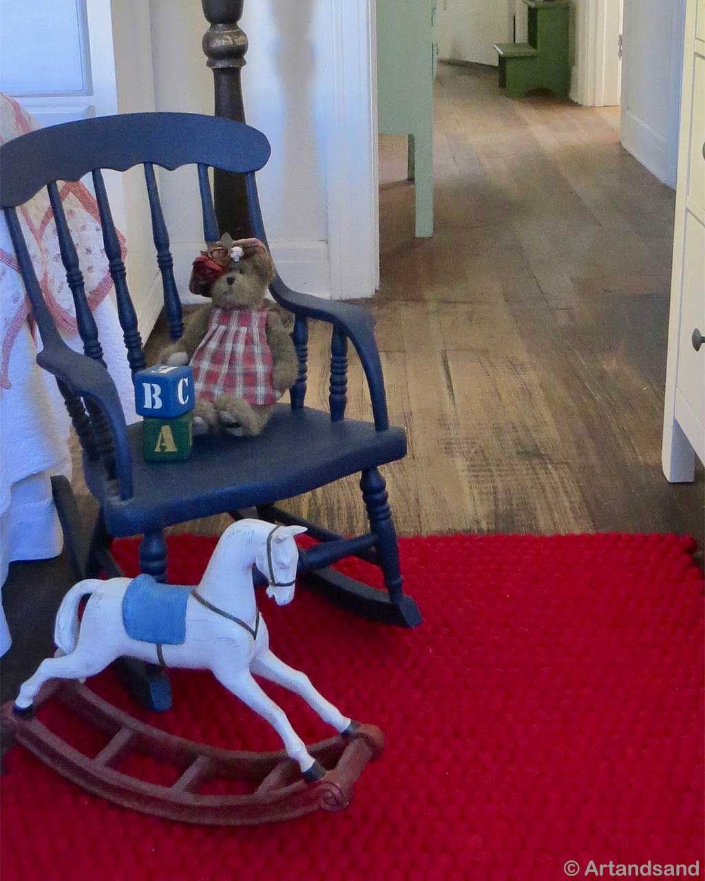 handmade toy horse and blue chair made by nepalian rugs
