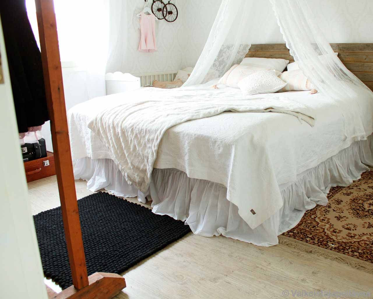 wooden bed with white bedsheet made in nepal contemporary room rugs