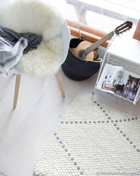 white chair with fluffy cover nepalese danish design rugs