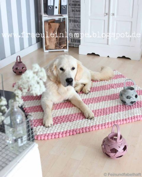 white dog and decoration pieces from nepal rugs