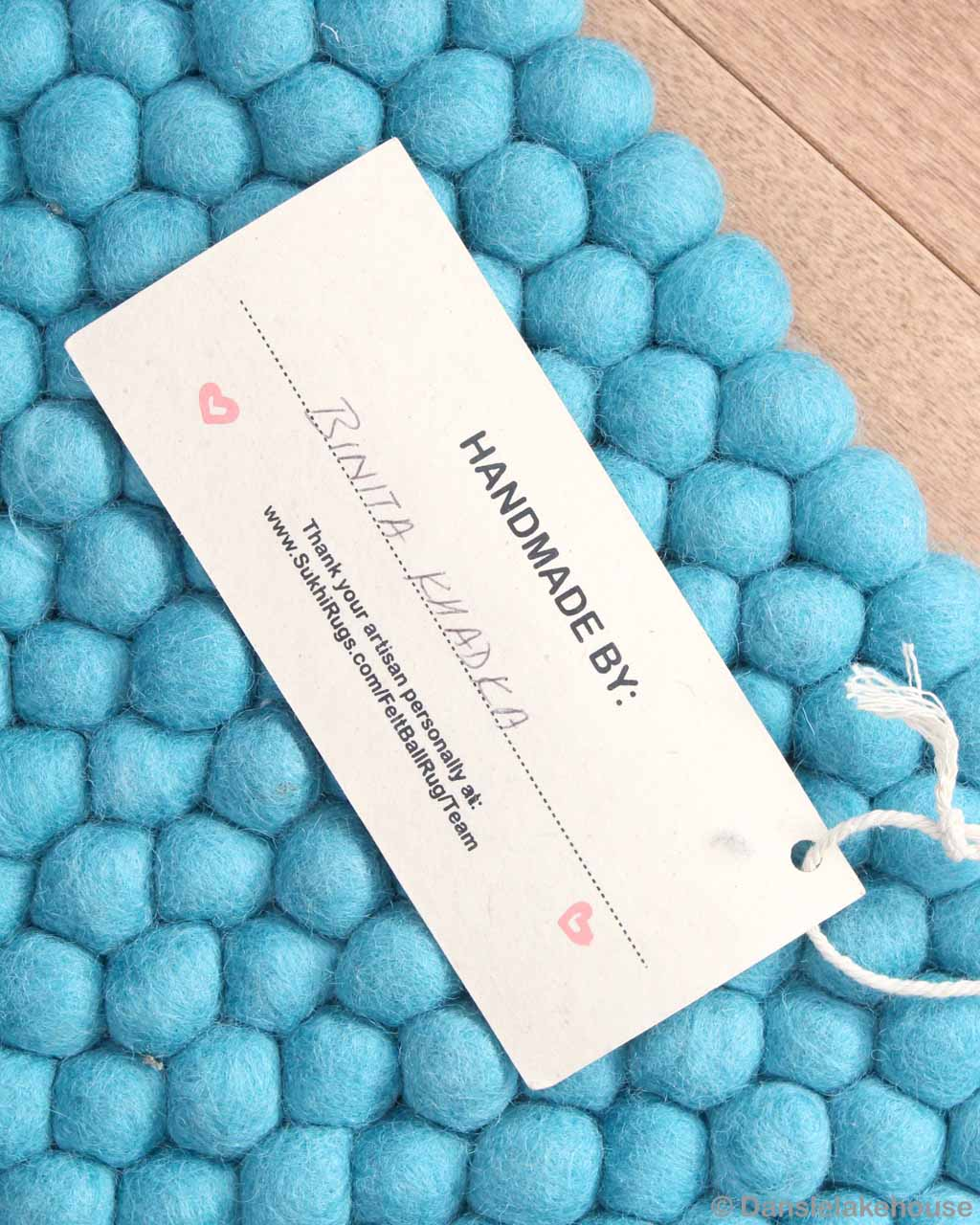 artist name tag from nepal cyan felt ball rugs