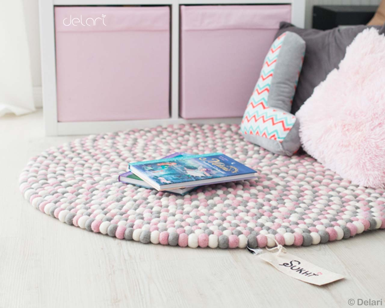 books and multiple pillows nepalese modern rugs