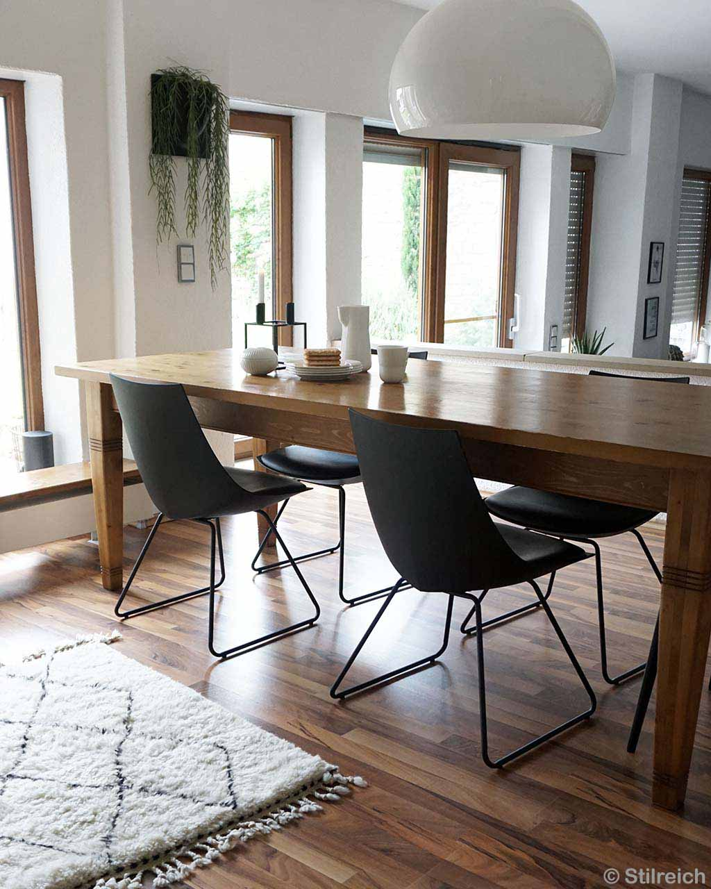 brown wooden table with black chairs moroccan made fresh bedroom rugs