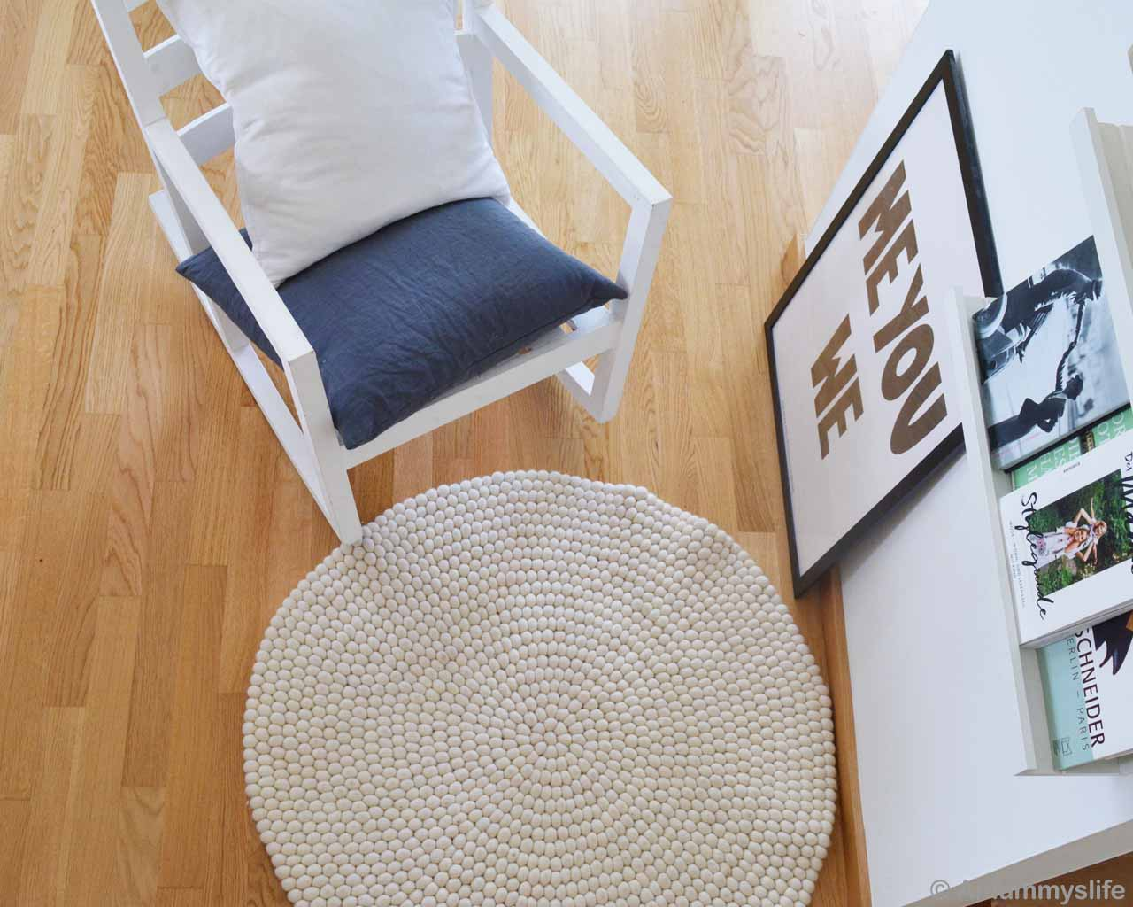 chair painting and books nepalese traditional vintage rugs