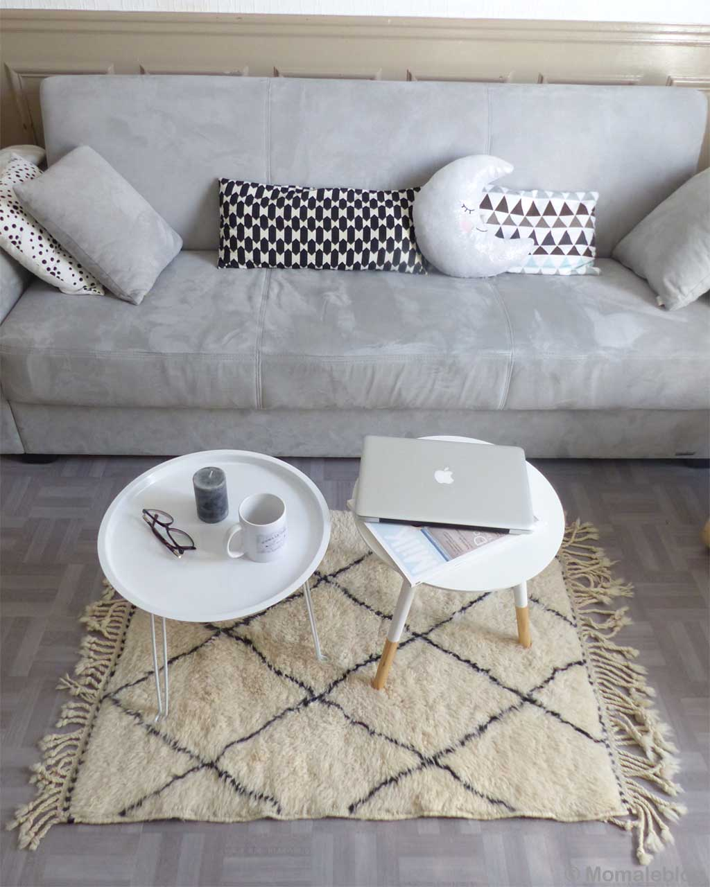 hand knotted gray sofa with cushions and round tables made by moroccan modern accent rugs