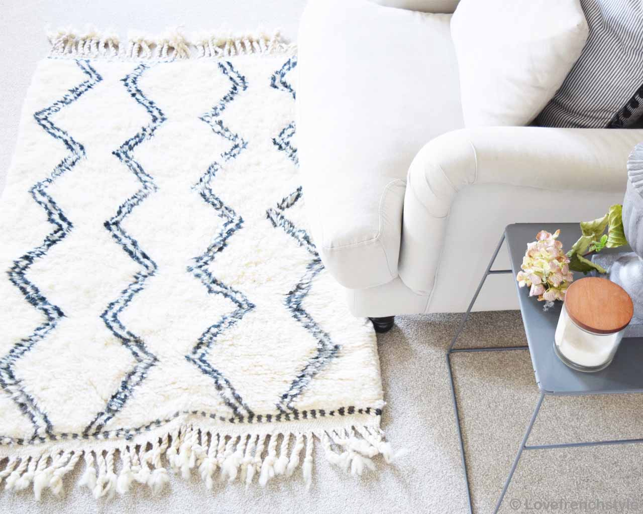 hand knotted sofa chair with cushions and side table berber rugs
