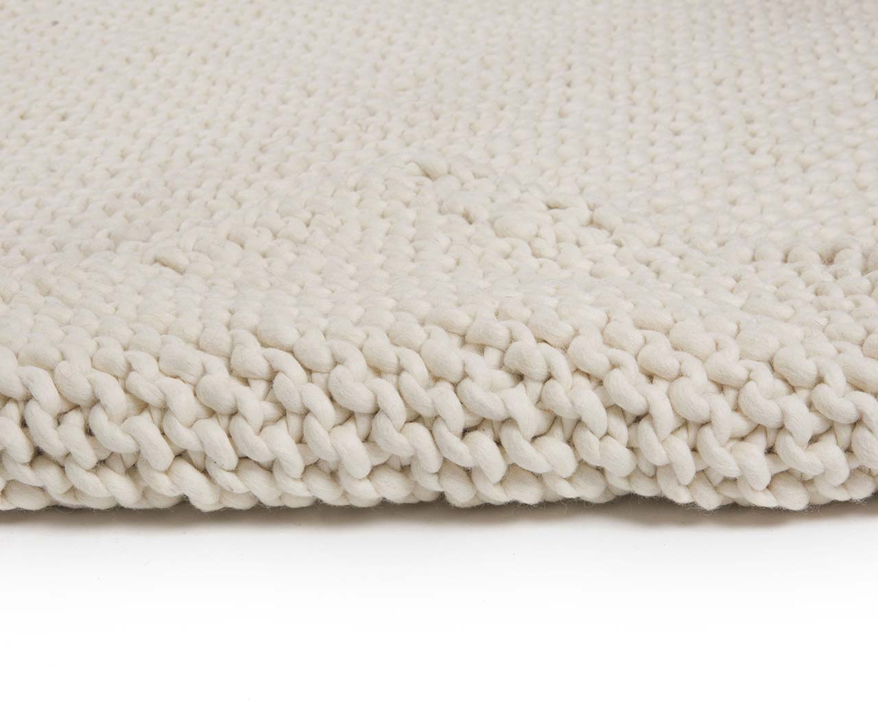 ivory woolen braided soft small rugs