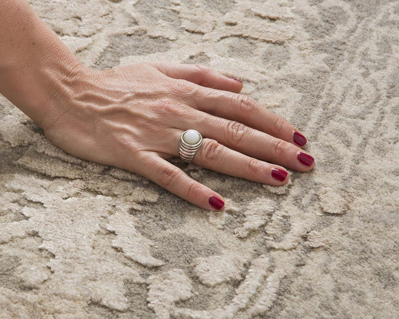 silver handmade hand with nail polish oriental carpet stores near me
