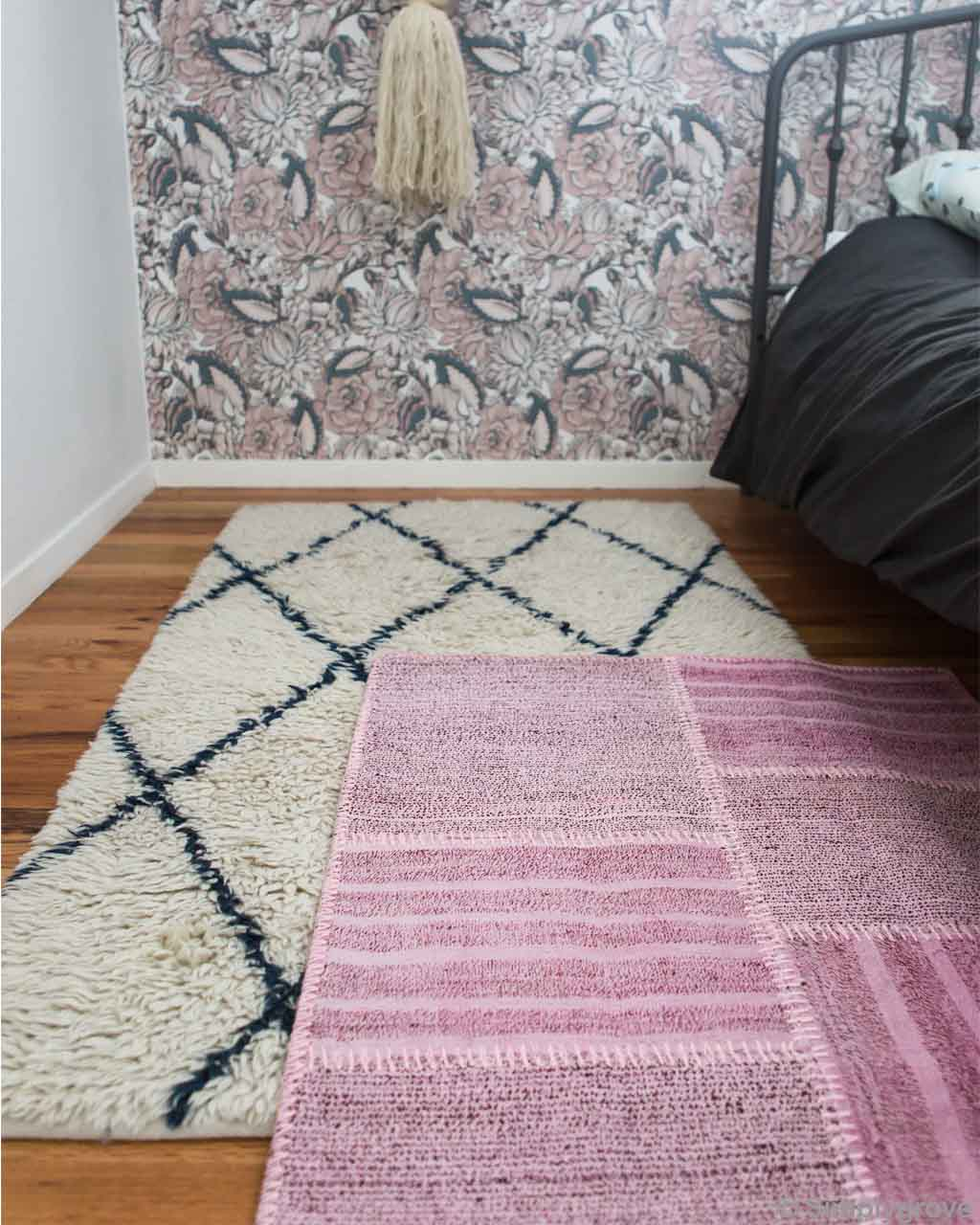 steel bed with black bed sheet asian contemporary floral rug