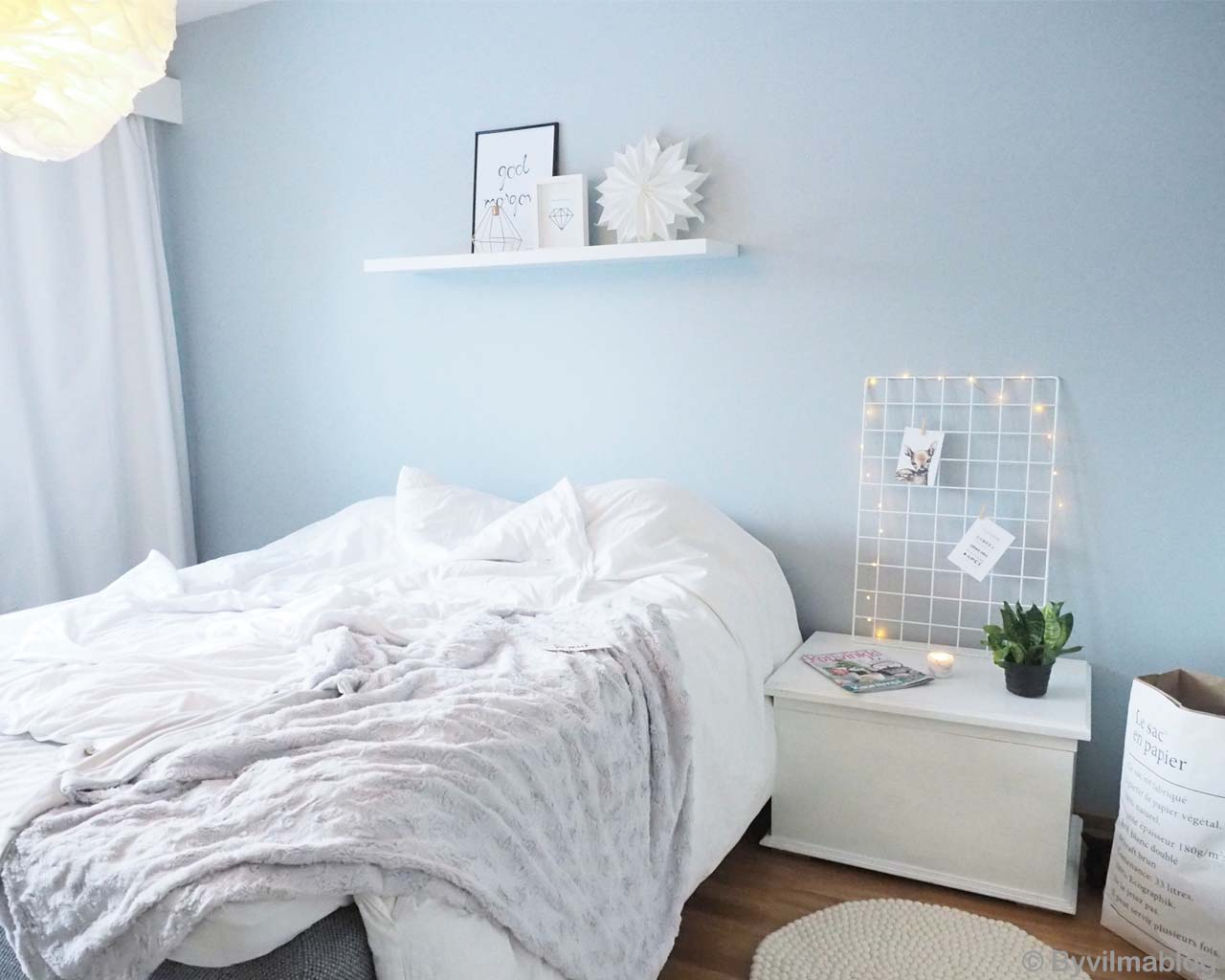 white bedsheet on bed made by nepalian contemporary rugs