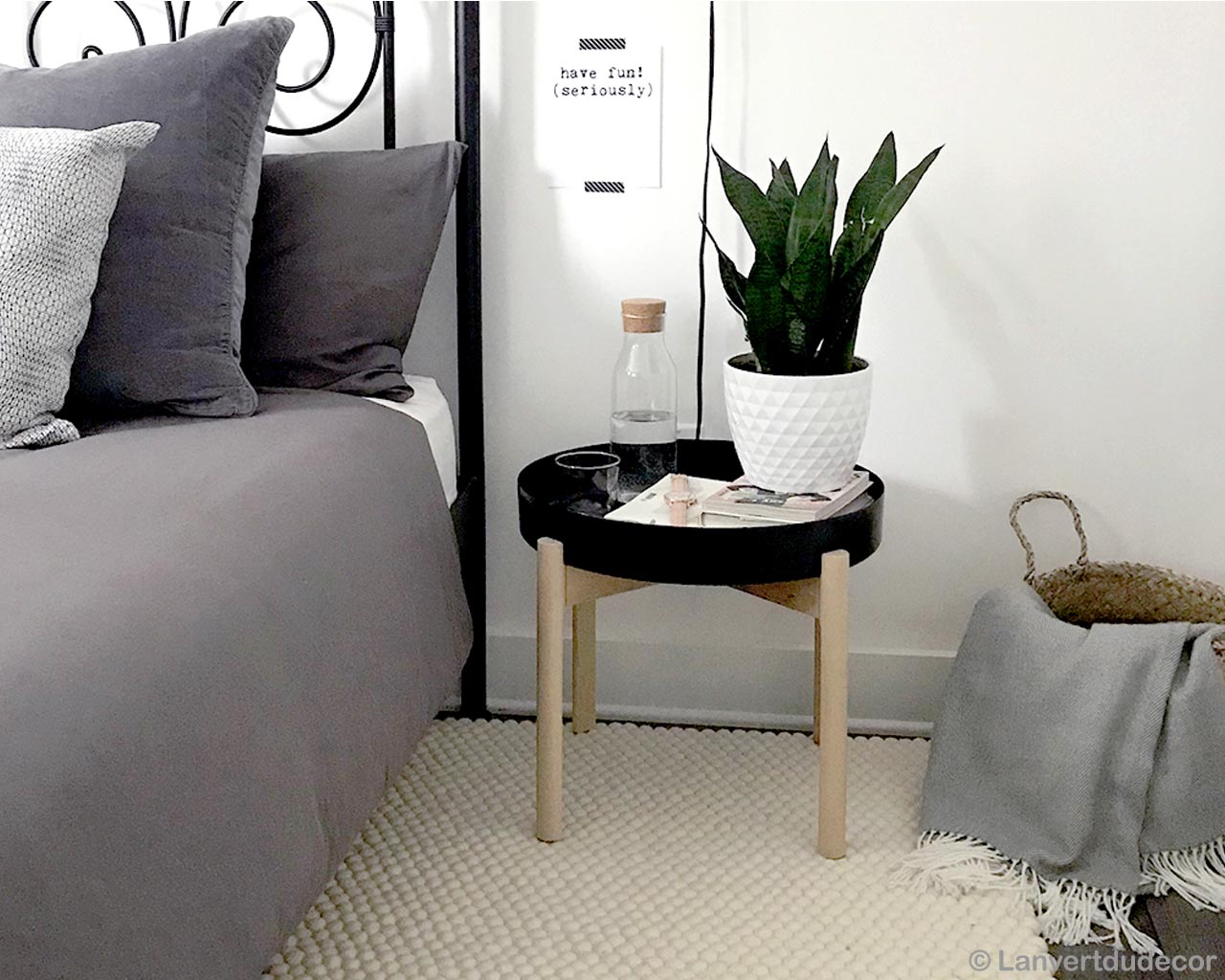 white vase and green plant made by nepalian danish design capel rugs