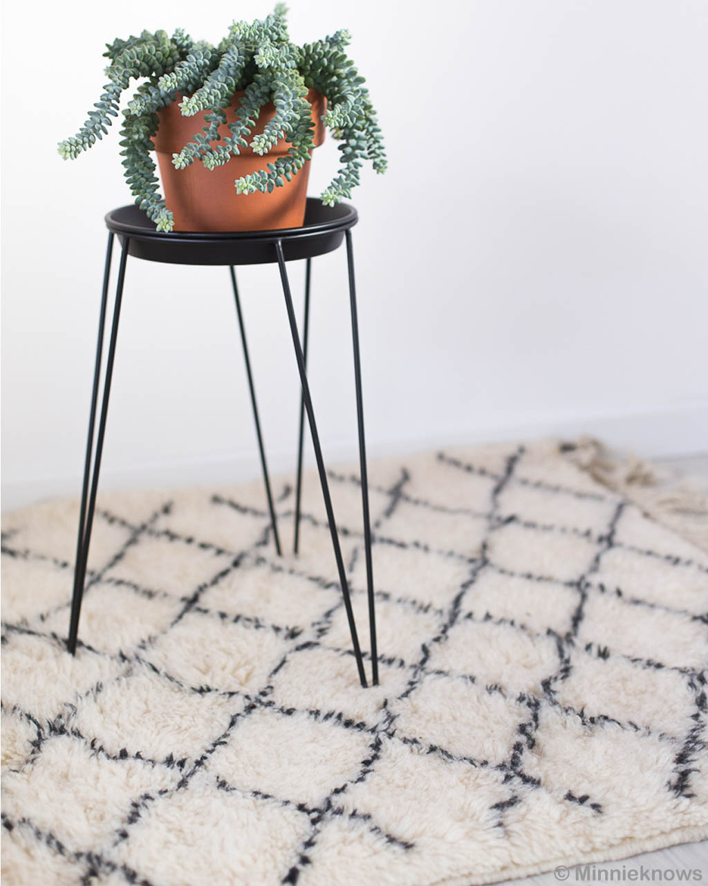 woolen round black table with pot made by moroccan contemporary room rugs