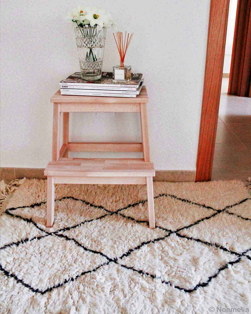 woolen side table with books and flowers berber oriental rugs