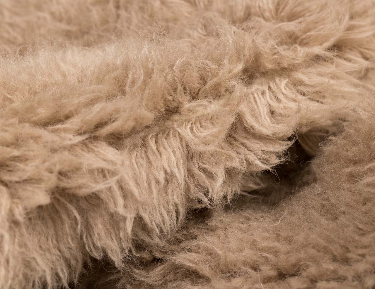 feathery brown round rug