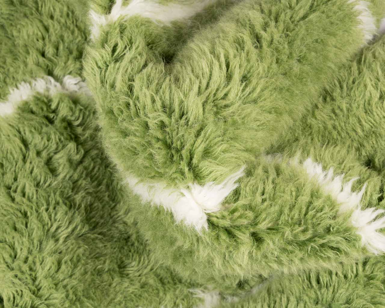 feathery round green rug with rhombus