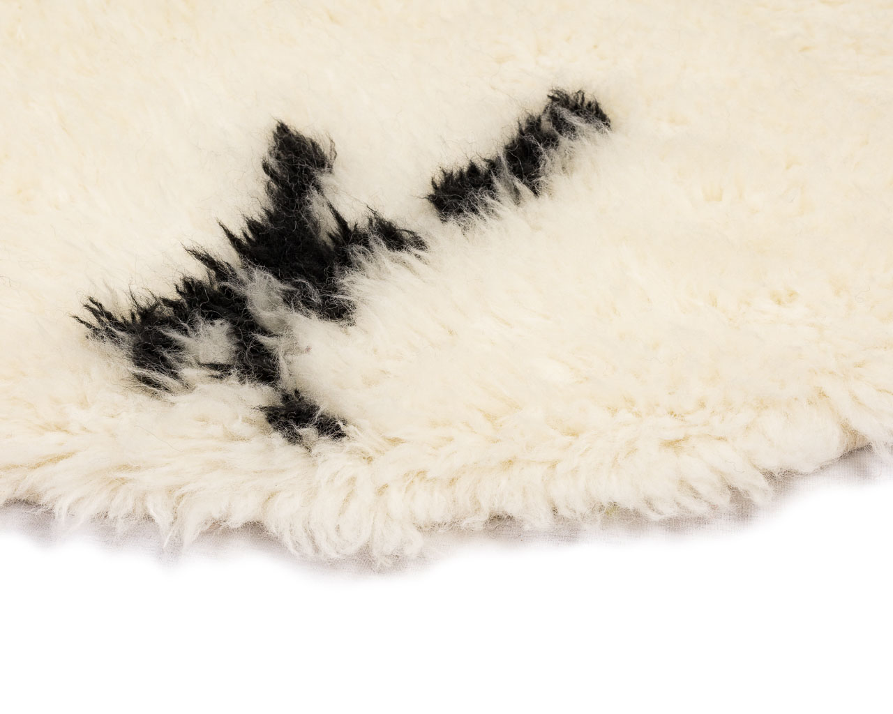 feathery-rug-in-round-with-black-symbols
