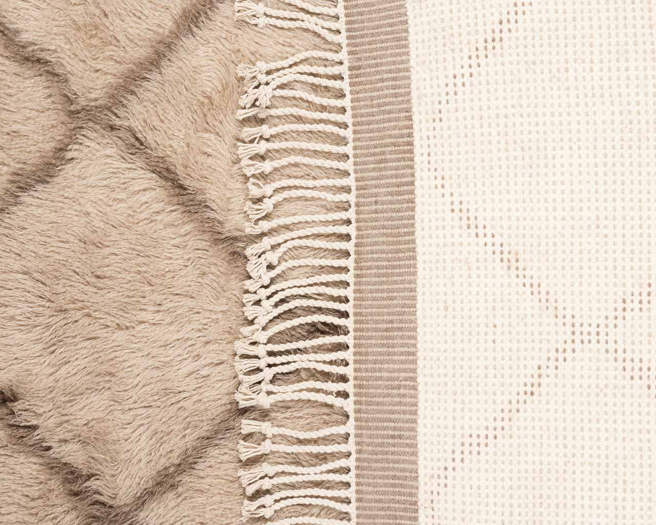 front and back of rectangular marro rug rhombus brown fringes