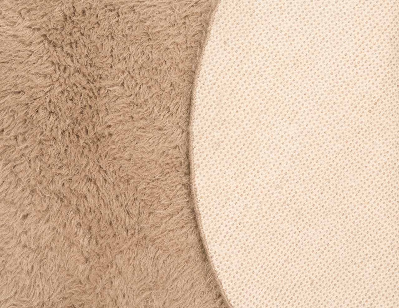 front and back side of brown round rug