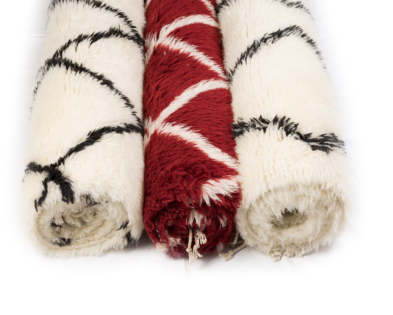red and white rugs with borders