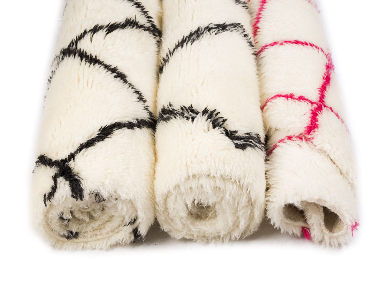 white rugs with black and pink borders