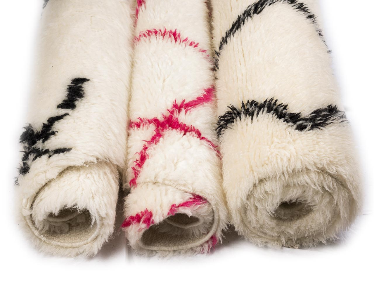 white rugs with multicolor borders