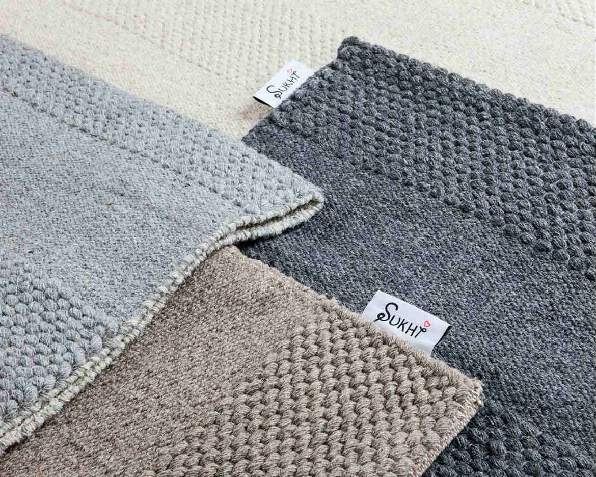 four-designs-of-unique-flat-weave-hygge-sukhi-rugs-in-different-colors